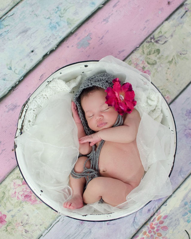 My studio is set up and chock full of props would love to capture your newborns special moments in photographs for you